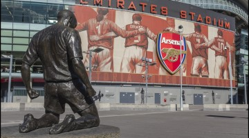 Thierry Henry bronze statue outside the south Clock End of the Emirates Stadium. Home of the Arsenal Football Club - London, United Kingdom