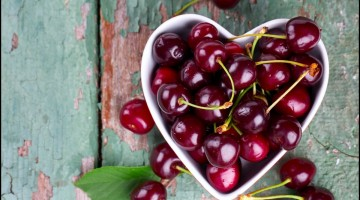 cherries in a heart-shaped bowl