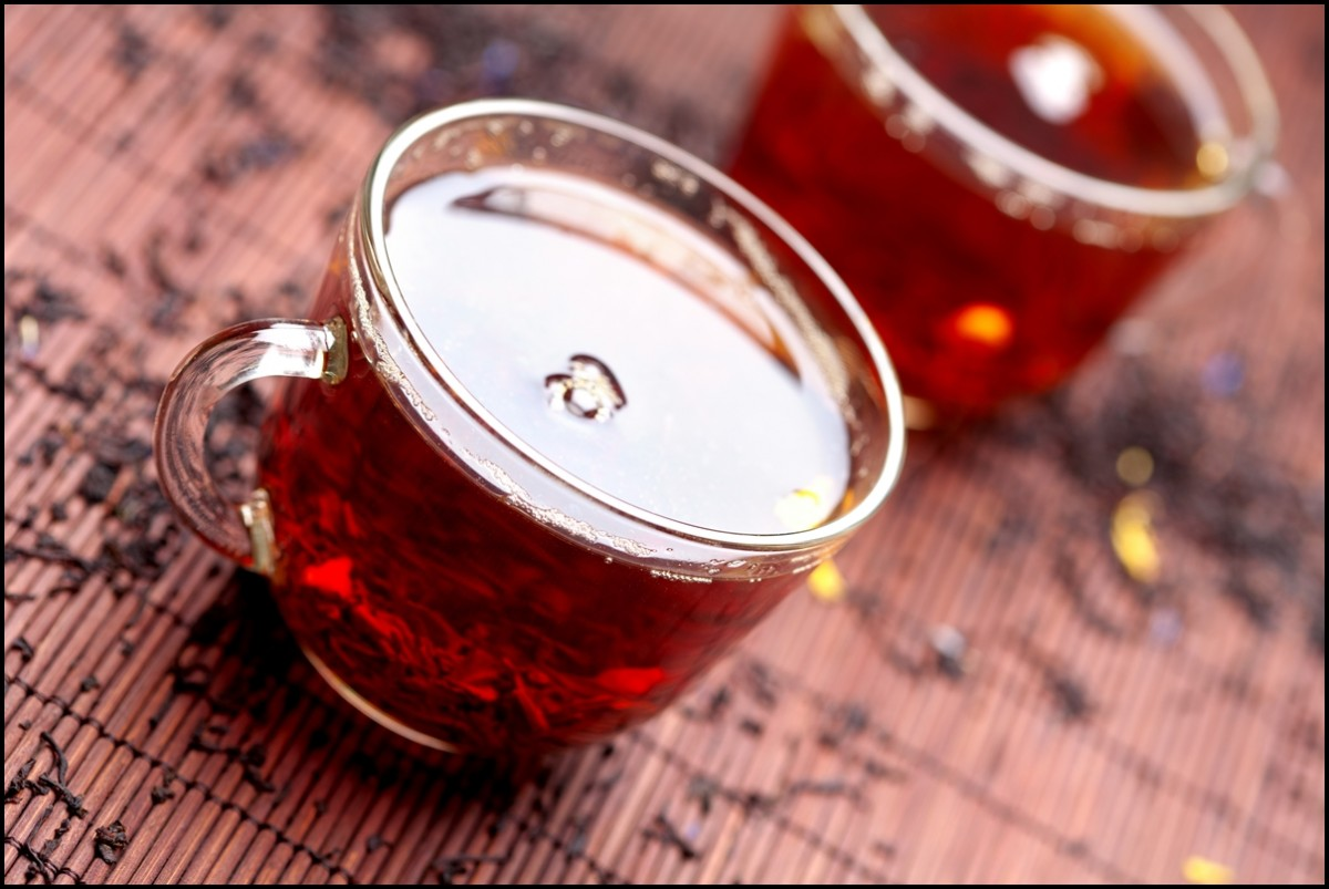 2 cups of organic black tea with tea leaves