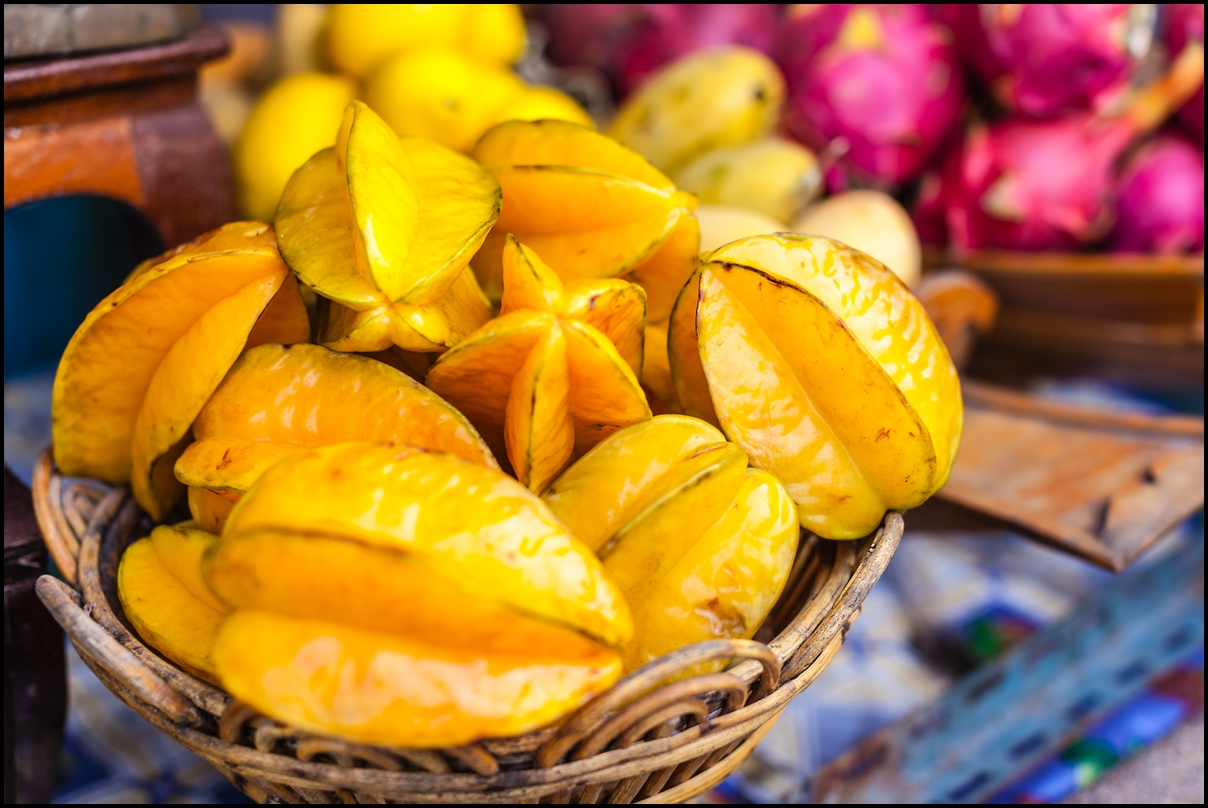 A basket of starfruits on a thai market stall in Bangkok, Thailand