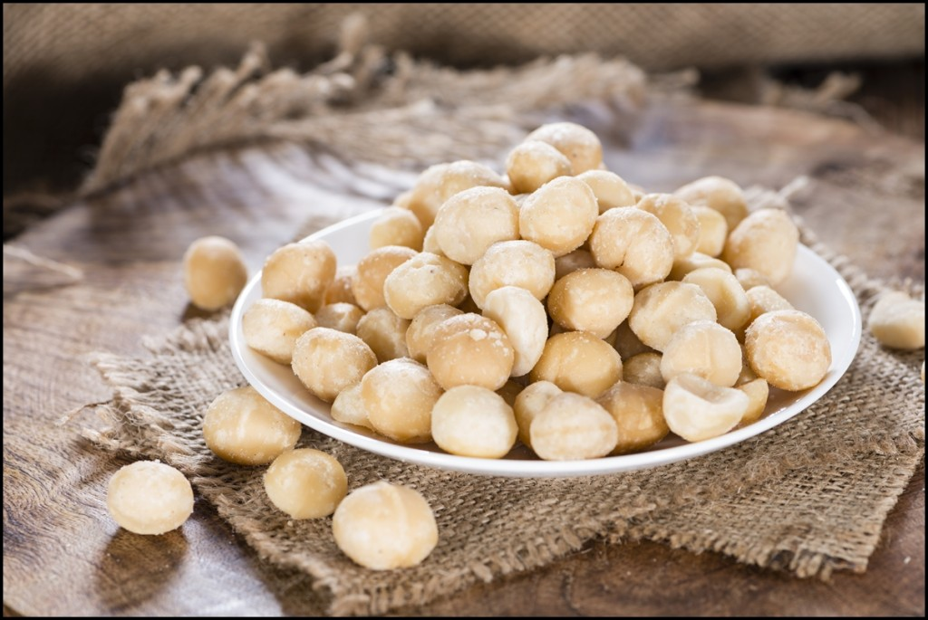 A bowl filled with fresh Macadamia nuts