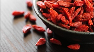 A bowl of red dried goji berries
