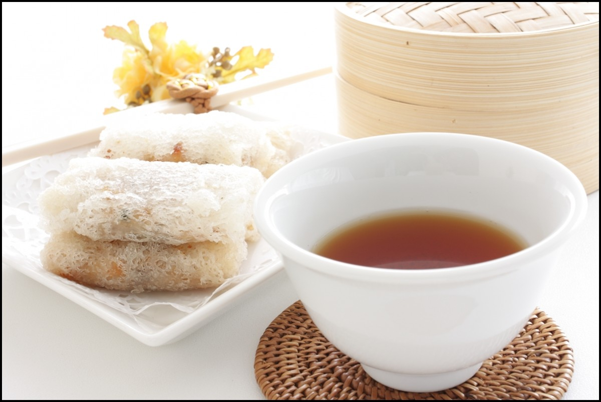 A cup of hot chinese Pu-erh tea and dumpling