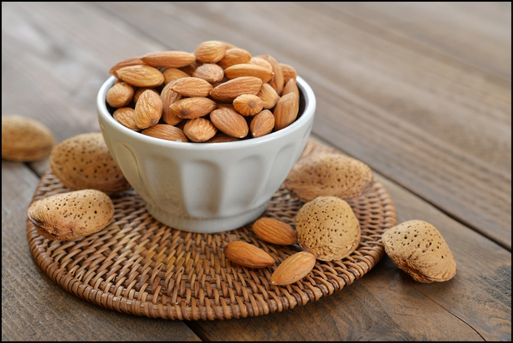 A small bowl filled with fresh Almonds. A perfect healthy snack