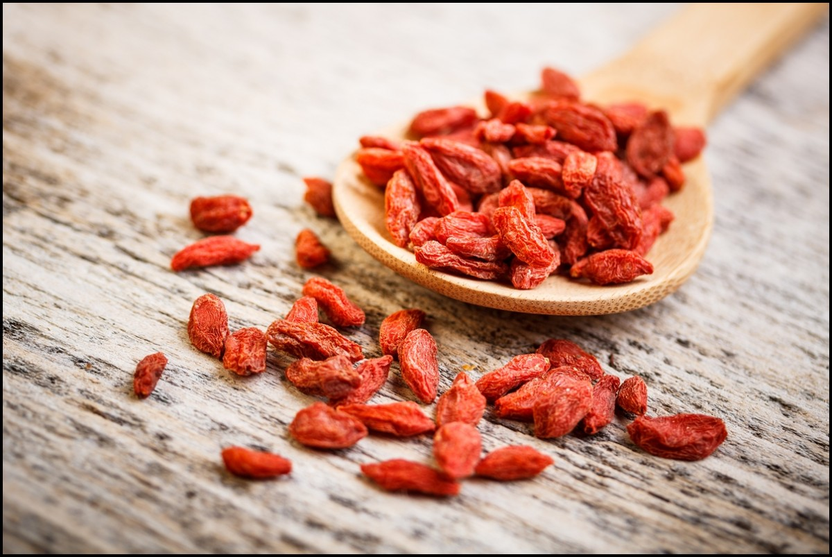 A wooden tablespoon of dried goji berries
