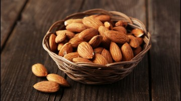 Almonds in brown wooden basket