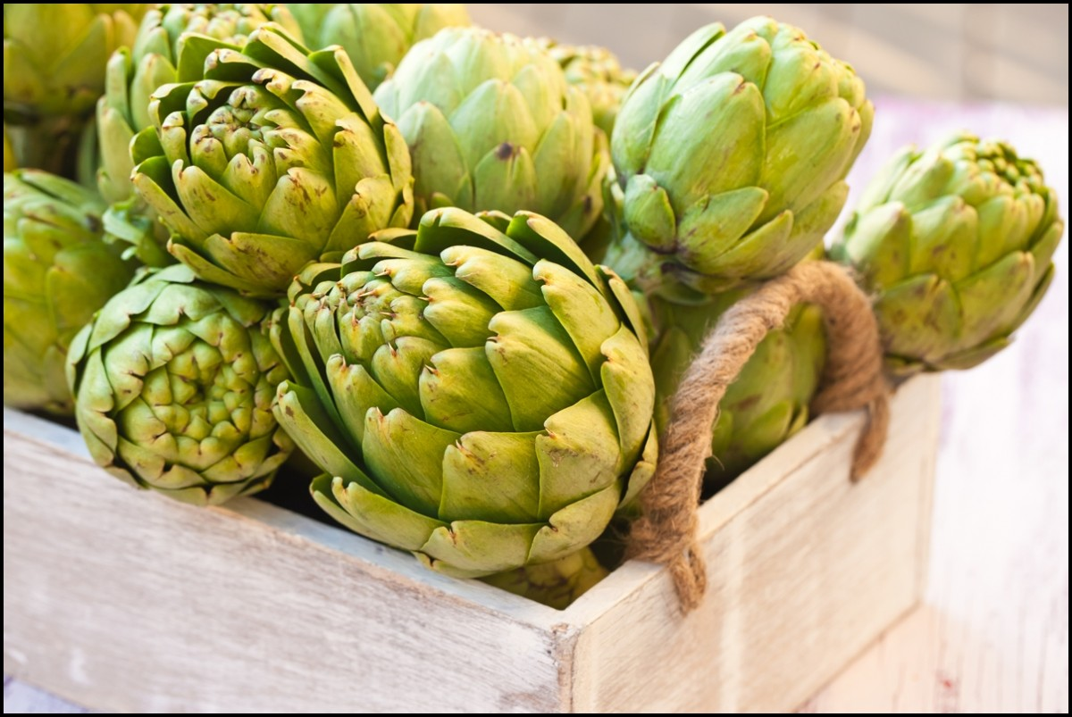 Artichokes in wooden basket close up