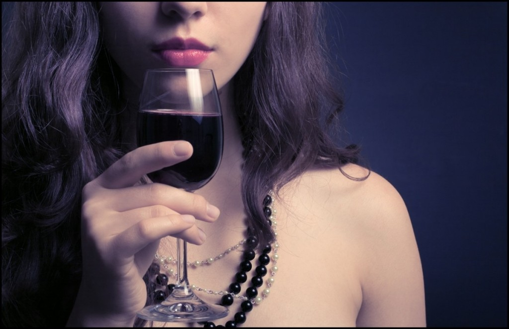 Beautiful Woman with a glass of wine on her hand