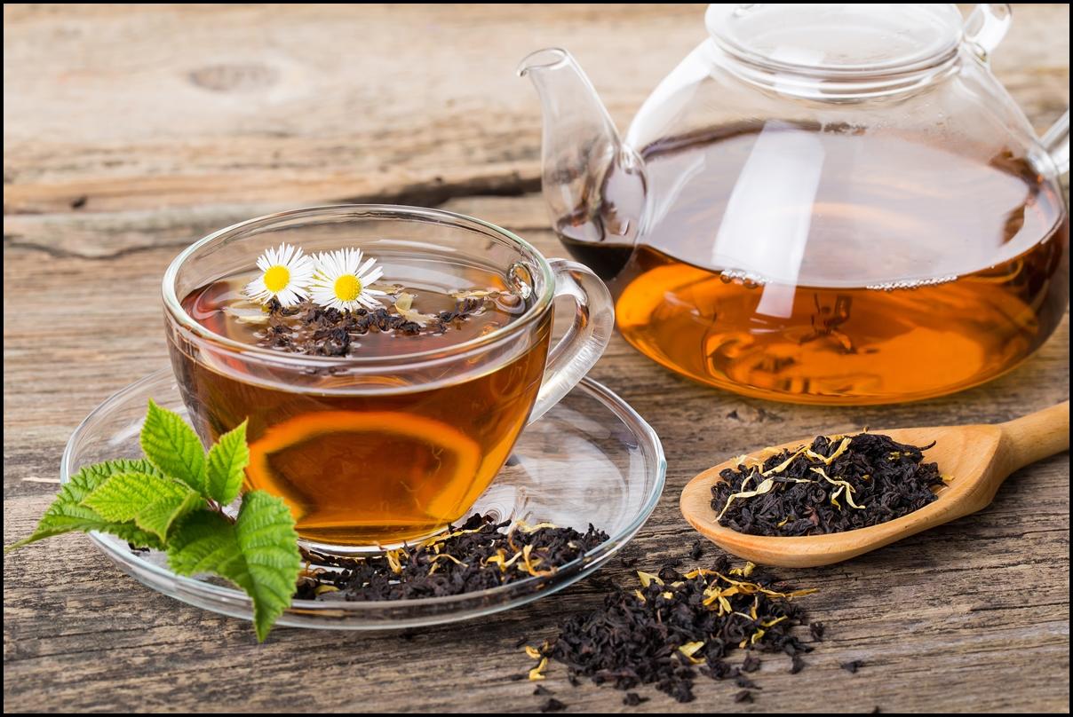 Black tea composition with mint leaf on wooden palette