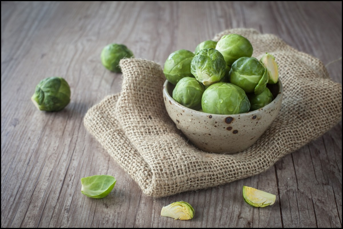 Brussel Sprouts in a bowl on wooden floor