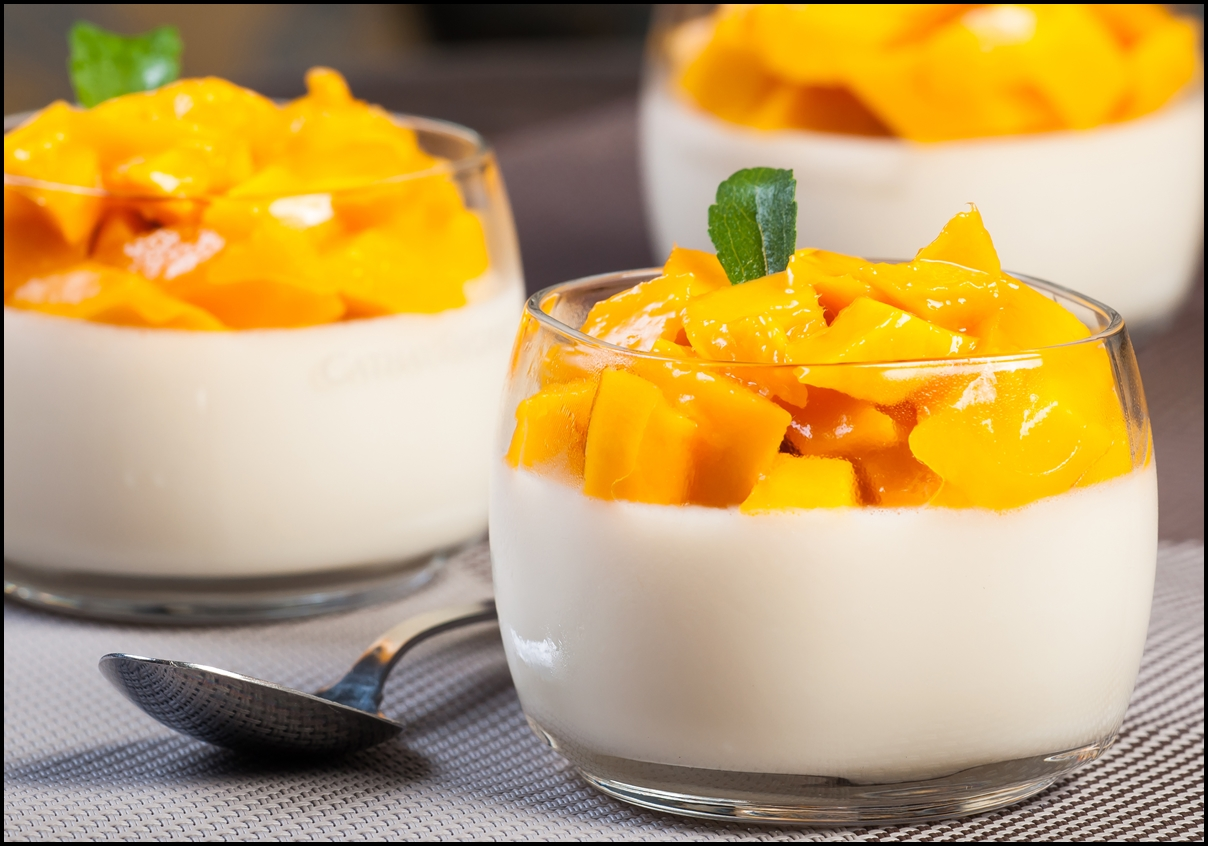 Cream and gelatin mix with flavourings and topped with mango