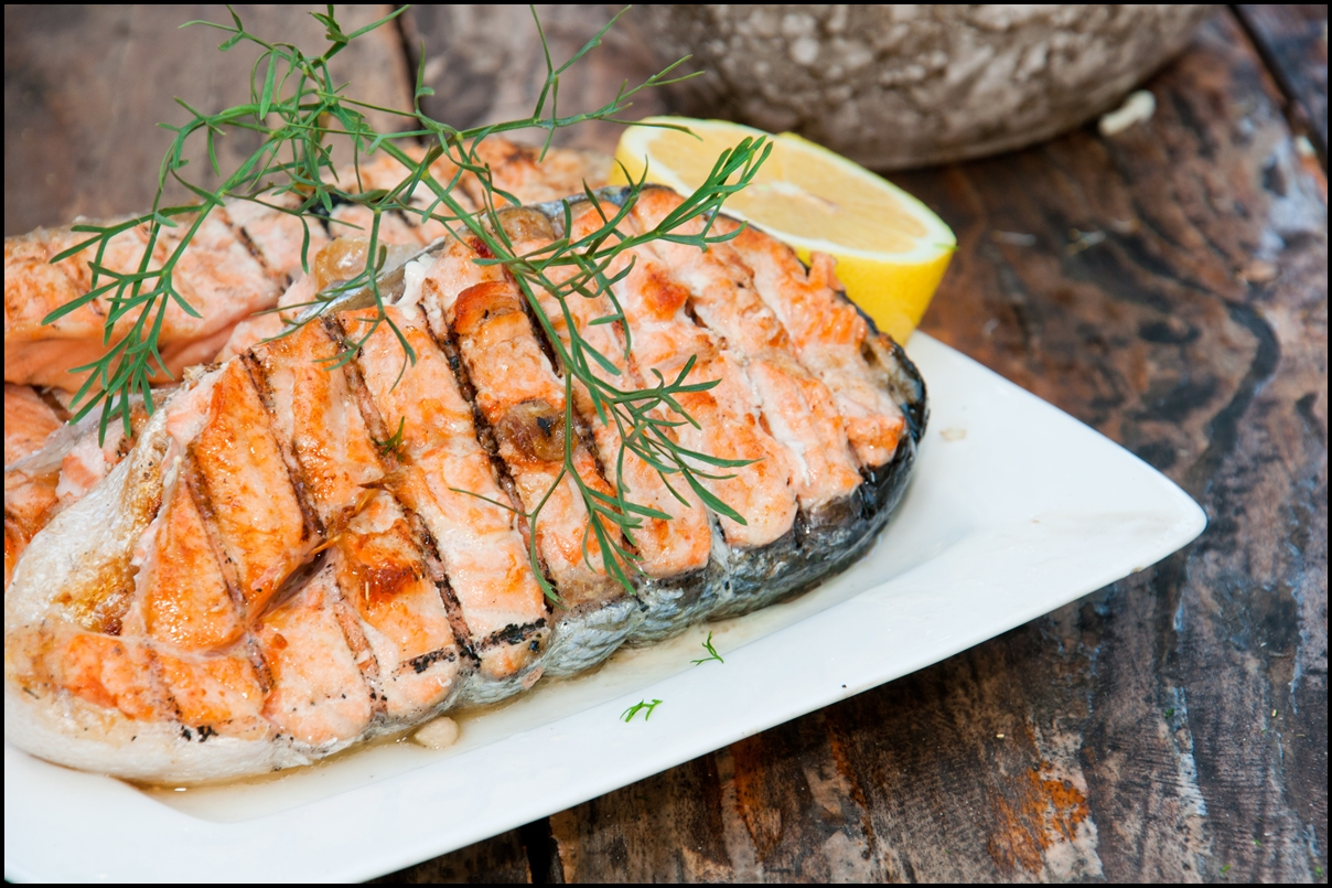 Delicious Salmon steak grilled with lemon