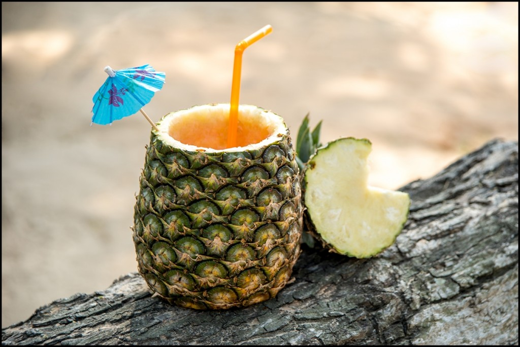 Exotic cocktail drink in a pineapple
