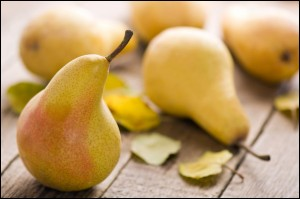 Fresh Pears on wood table closeup