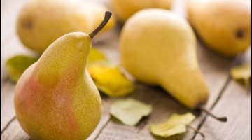 Fresh Pears on wood table closeup