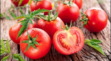 Fresh Tomatoes Closed up on wooden background