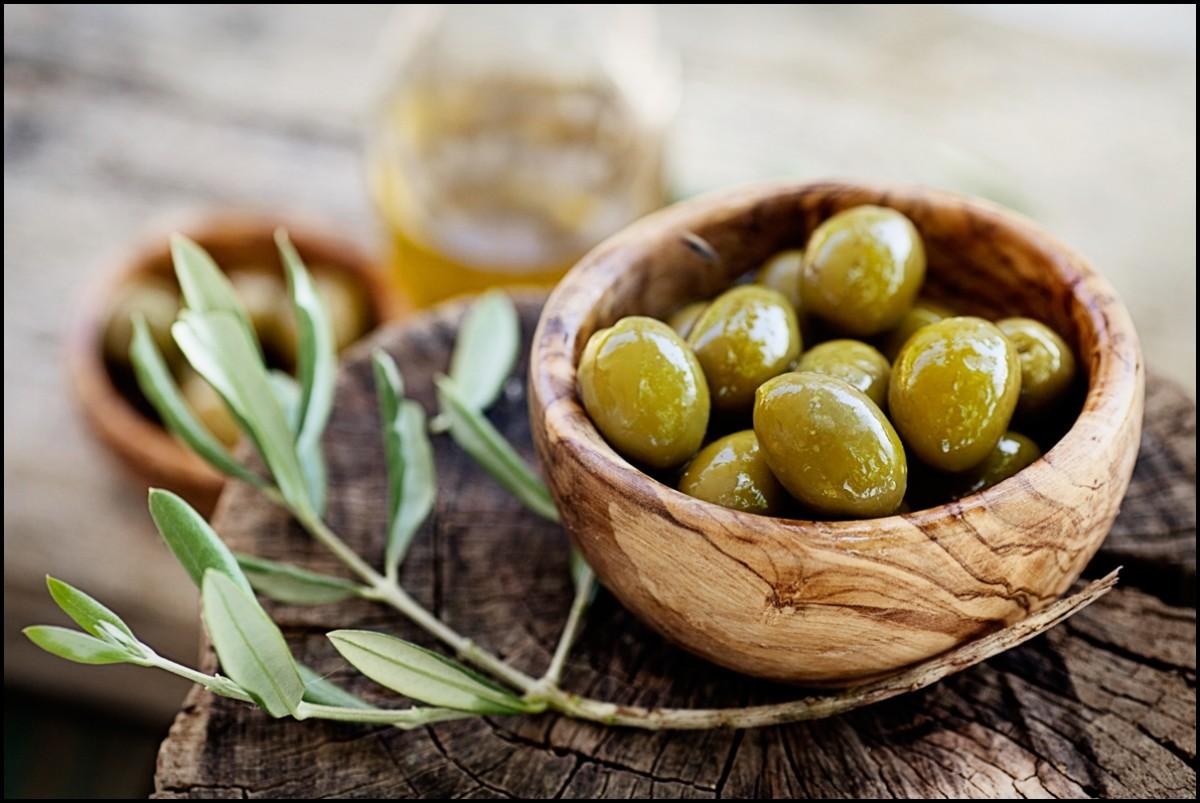 Fresh olives and olive oil