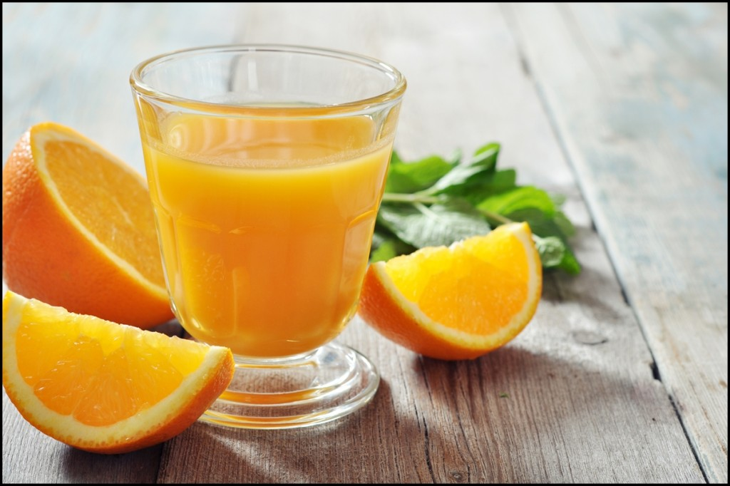 Fresh orange juice in glass with mint