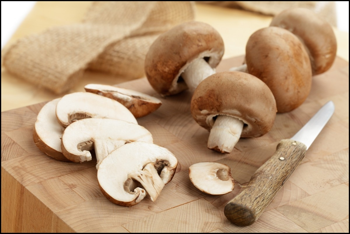Fresh sliced brown mushrooms close up