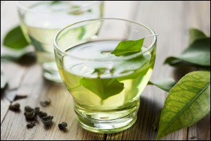 Glass cup with hot fresh green tea