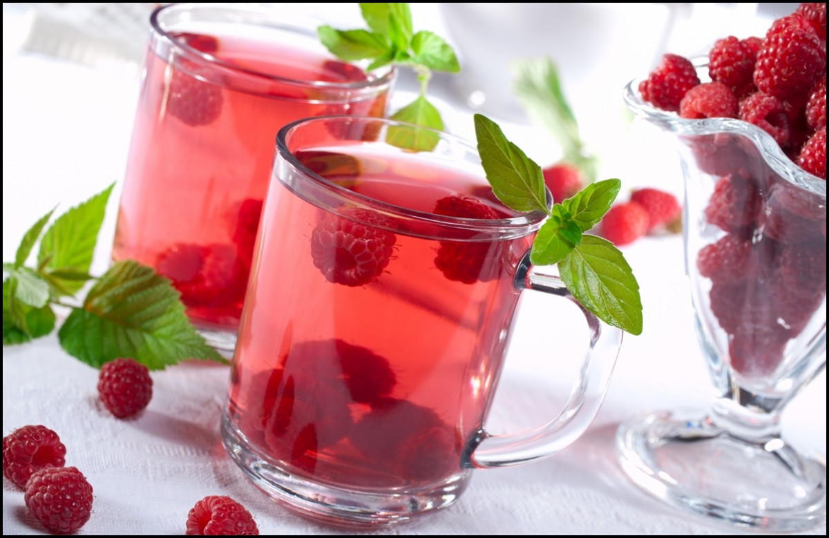 Healthy and cold raspberry drink with mint leaf