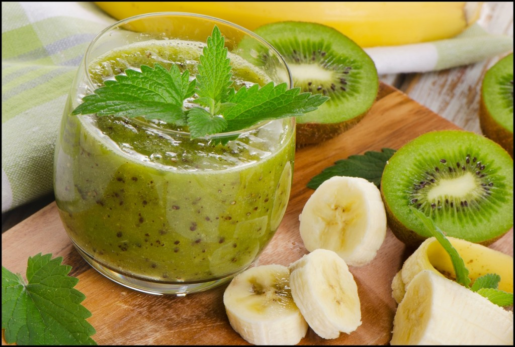 Healthy kiwi & banana smoothie in a glass with peppermint
