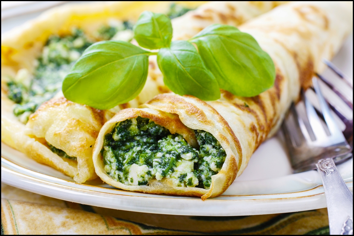 Mediterranean cuisine - crepes stuffed with cheese and spinach