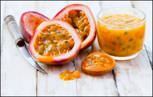 Passion fruits and freshly made passion fruit juice
