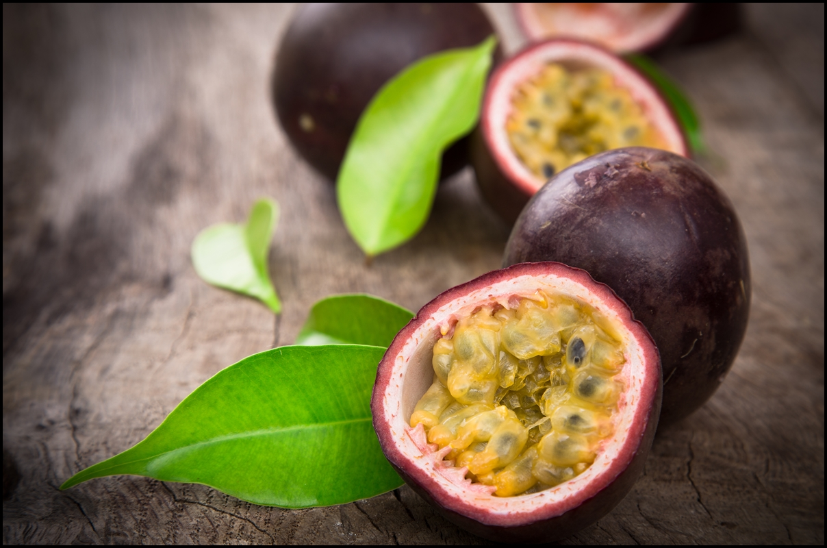 Passion fruits with leaf on wooden background