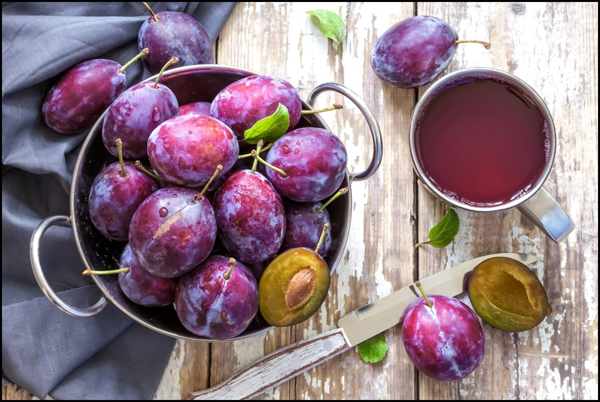 Plums and fresh plum juice
