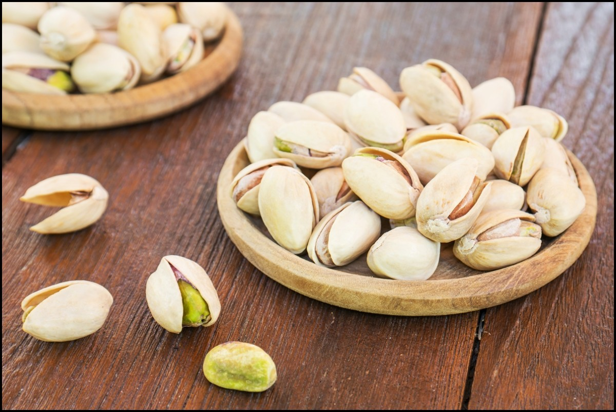 Roasted pistachio on wooden plate