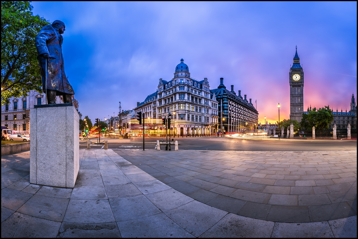 Statue of Winston Churchill (left). Panorama of Parliament Square and Queen Elizabeth Tower in London, United Kingdom
