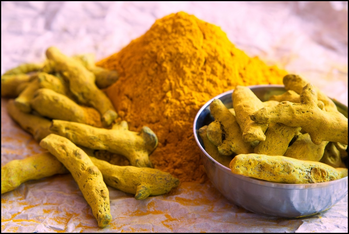 The Health Benefits of Turmeric. Turmeric powder and turmeric sticks