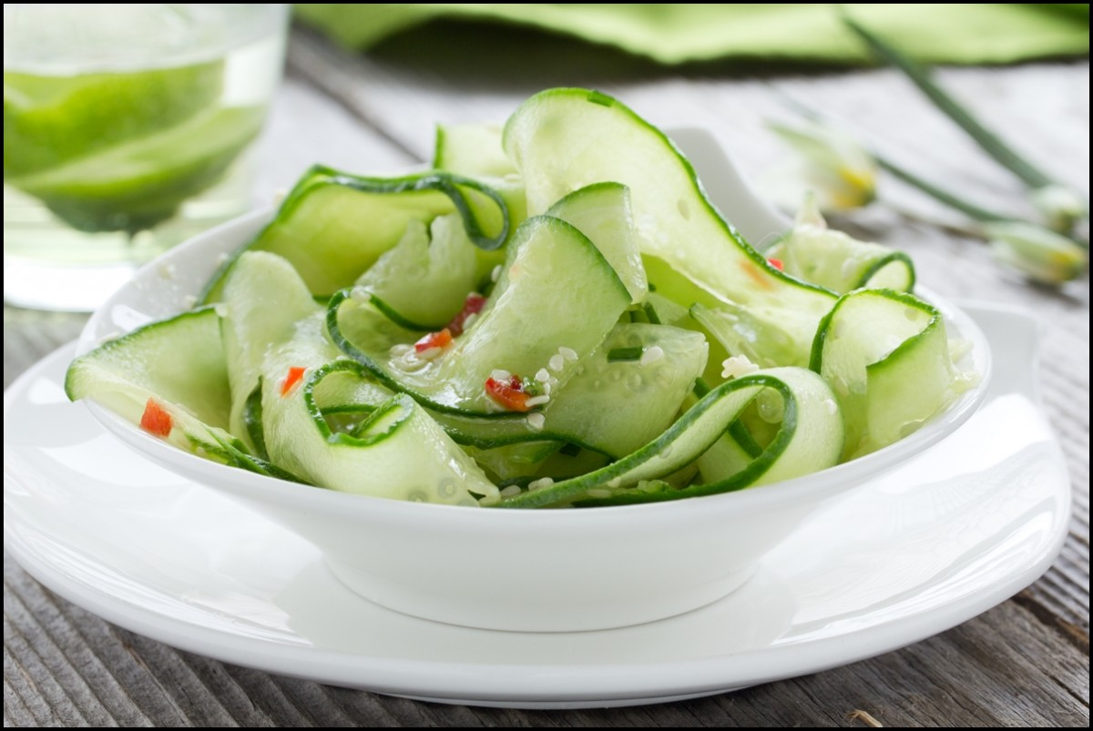 Yummy Cucumber Salad Close Up. With a cup of cumumber water