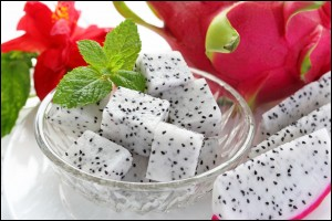 Yummy Dragon fruit for dessert in a bowl with peppermint leaf