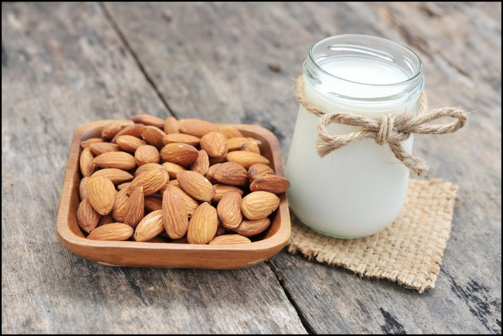 almonds milk with almonds on a small plate