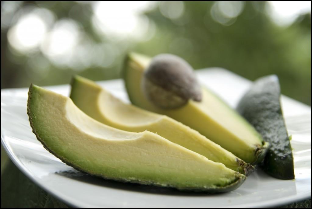 chopped avocado on a white plate