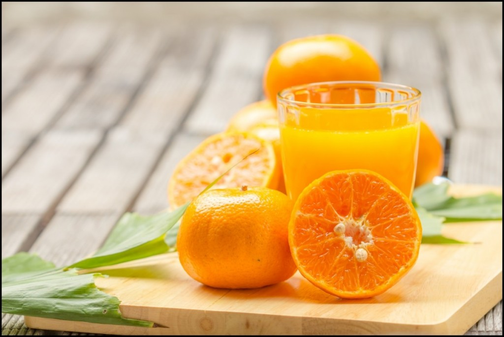 orange Juice and orange on the cutting board