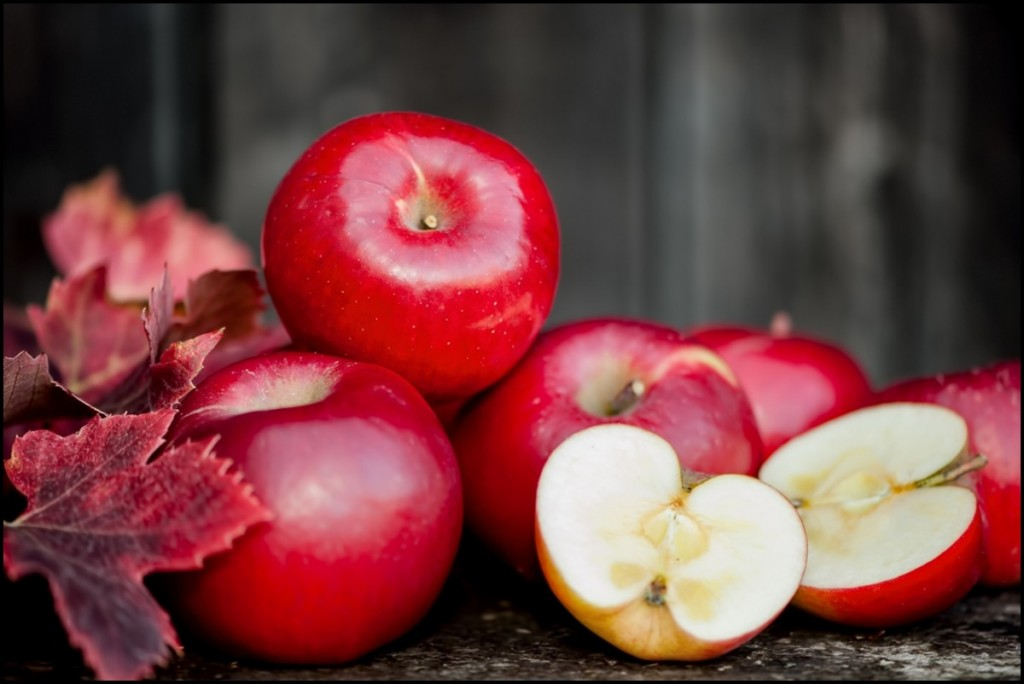 Organic Fresh Red Apples with Autumn leafs