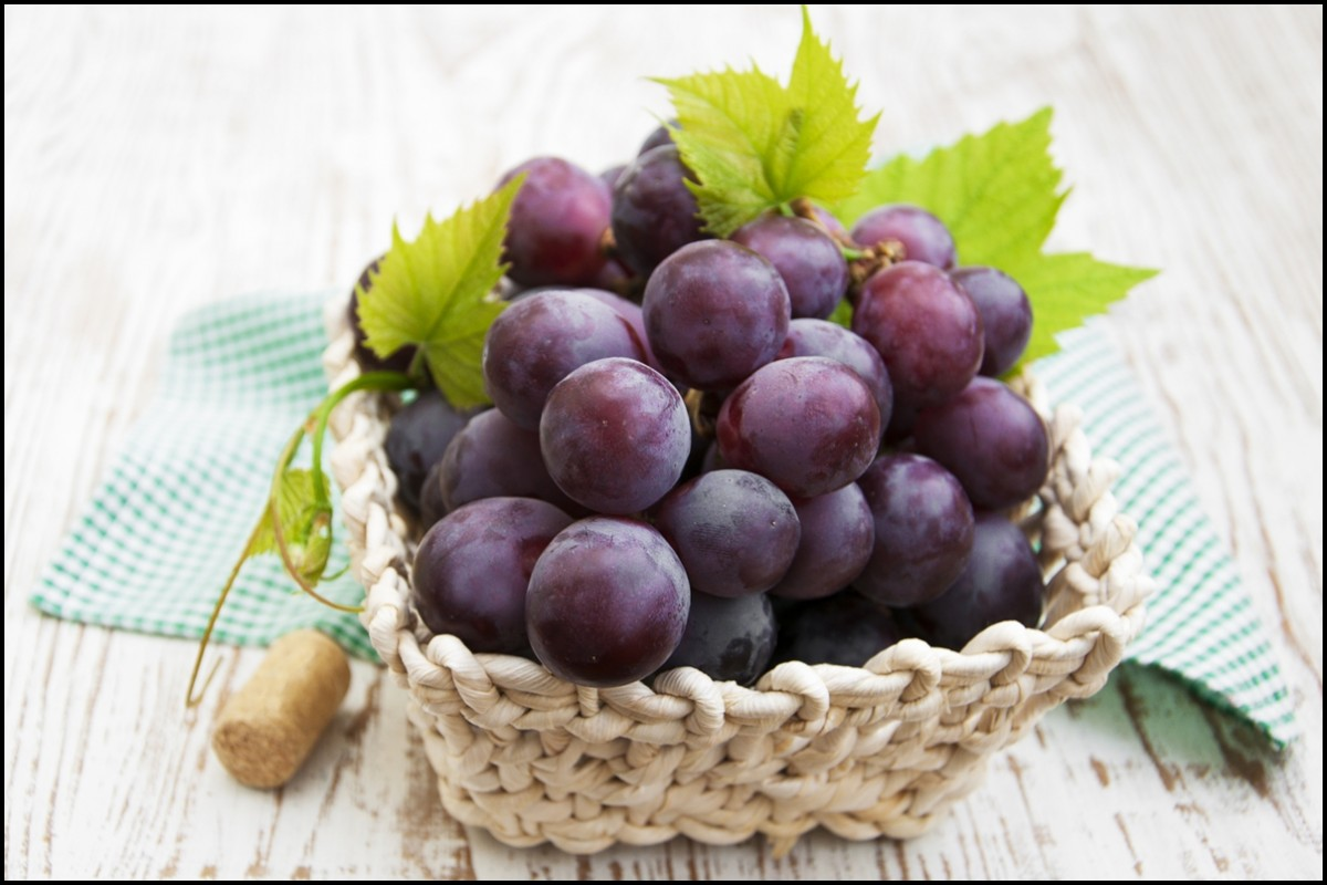 red grapes in basket