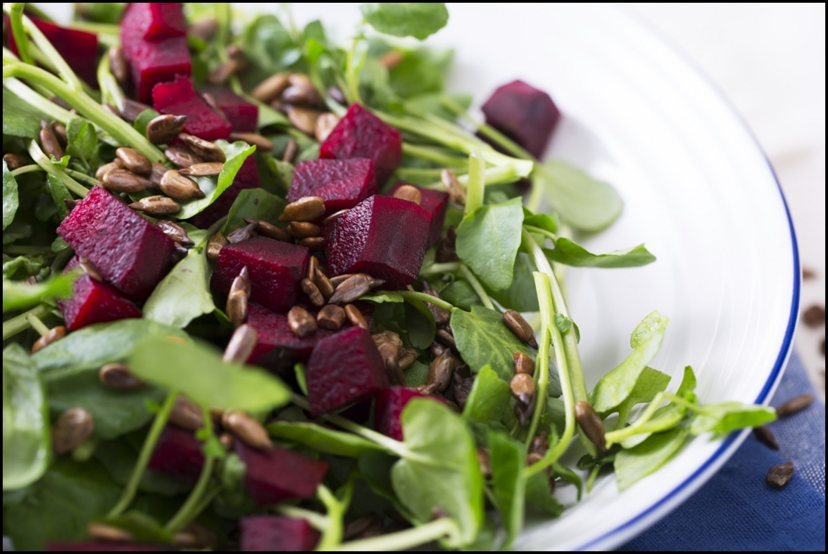 Watercress and beetroot salad with toasted sunflower seeds close up
